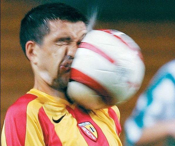 soccer-man-hit-in-face-with-soccer-ball